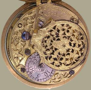 54eafd9cc6a Relógio de bolso de dupla caixa em ouro. A caixa exterior sem decoração